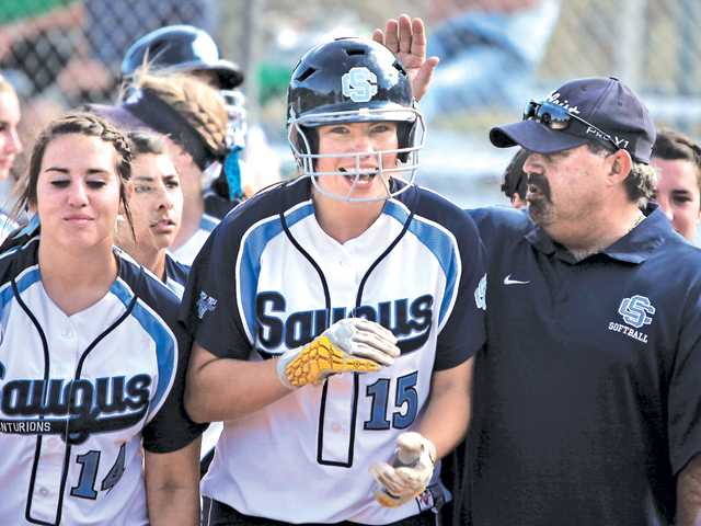 Saugus first baseman Taylor Kister (15) celebrates with her team after hitting a home run on Thursday at Saugus High.