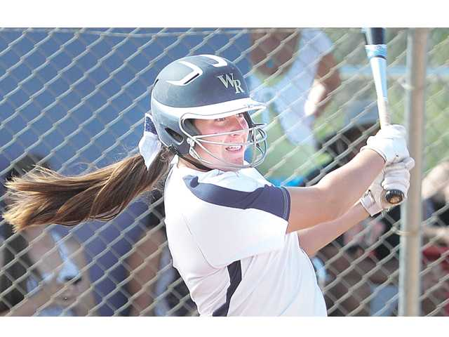 West Ranch's Keeley Walsh hits a two-run double in the fourth inning of Thursday's CIF-SS Division I first-round playoff game against El Modena at West Ranch High School. West Ranch defeated El Modena 3-1.
