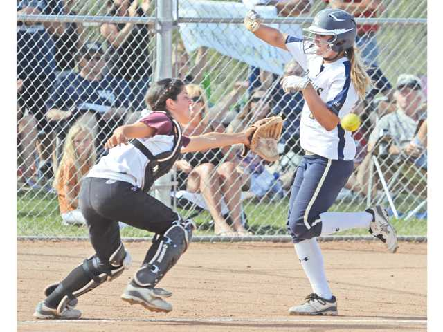 West Ranch's Julia Lombardi, right, avoids the tag of El Modena catcher Lauren MacLeod to score a run during Thursday's CIF-Southern Section Division I playoff game at West Ranch High School. Lombardi had three hits.