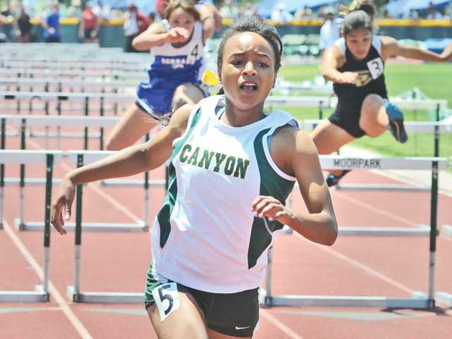 Canyon runner Taylor Thomas wins the 100-meter hurdles during the CIF-Southern Prelims on May 12 at Moorpark High.