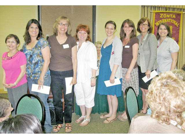 Zonta's Community Grants recipients with committee member Alicia Estrada, left, and chairwoman Michelle Dow, right.  Recipients, left to right, Denise Tomey of Carousel Ranch; Linda Davies and Pamela Braly, Domestic Violence Center; Janine Fairall, Boys & Girls Club of SCV; Kim Goldman, SCV Youth Project and DaAnne Smith, Single Mothers Outreach.