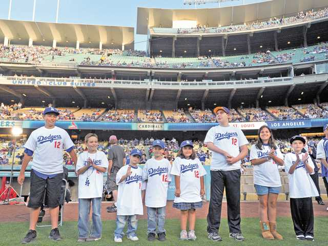 Kids Take The Field participants are introduced before the Dodgers' game against the St. Louis Cardinals at Dodger Stadium in Los Angeles on Saturday.