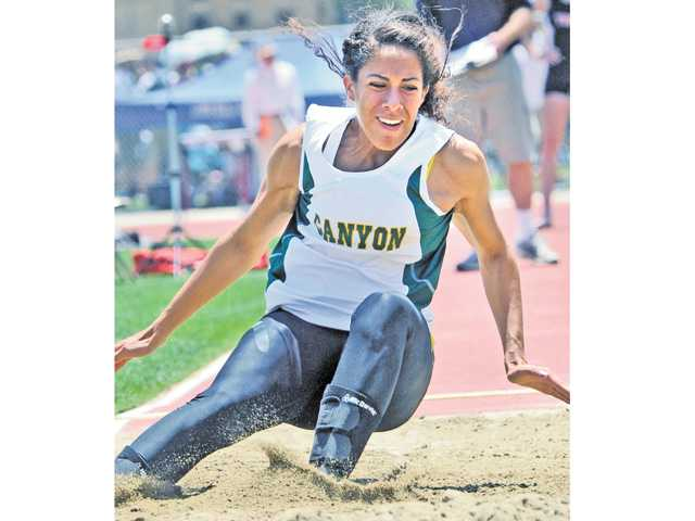 Canyon's Tiffini Stone competes in the long jump during the CIF-Southern Section track finals at Mt. San Antonio College on Saturday.