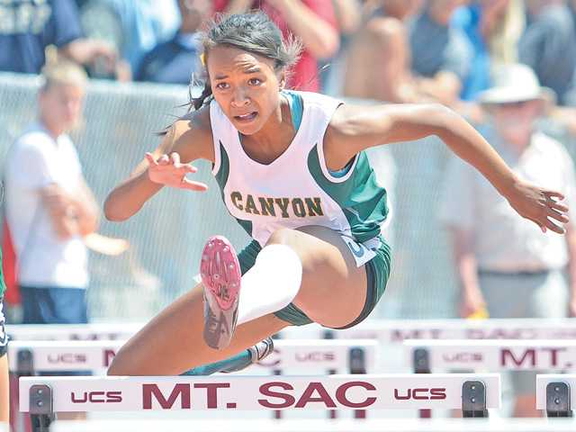 Canyon's Taylor Thomas wins the 100-meter hurdles at the CIF-SS track finals Saturday at Mt. SAC.