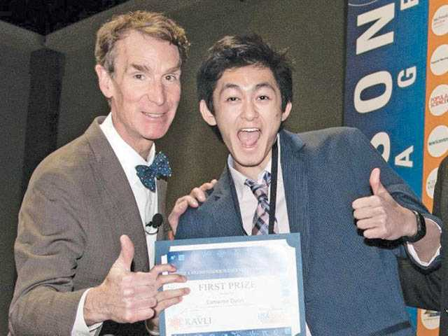Quon poses with Bill Nye the Science Guy during the USA Science and Engineering Festival in April.
