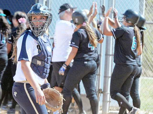 West Ranch catcher Janelle Lindvall looks back at her dugout after a Santiago grand slam on Tuesday at West Ranch.