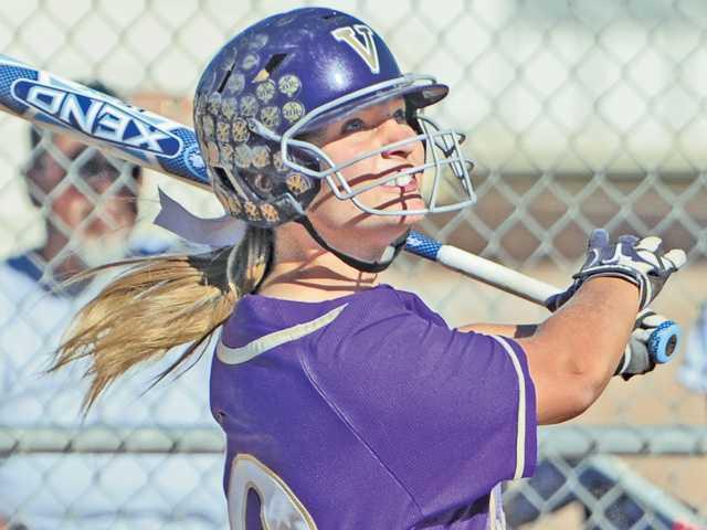 Valencia senior catcher Karlie Habitz follows through on her swing for a base hit on Tuesday at Valencia High School.