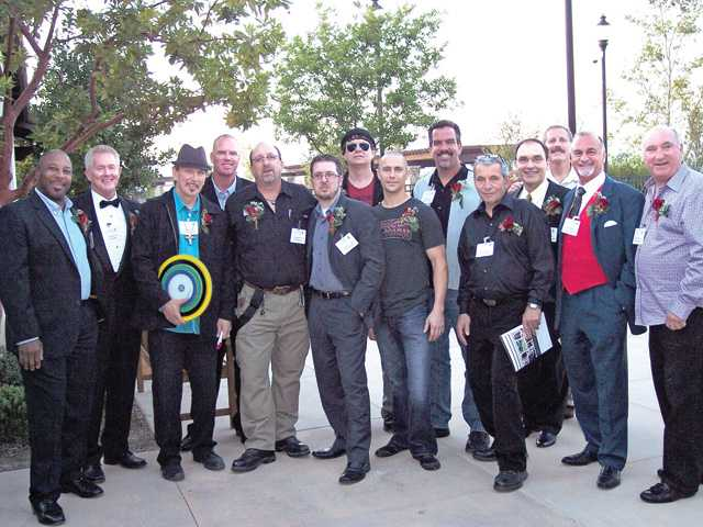 The Gentlemen for a Cause gather outside the Westridge clubhouse to wait their turn on the runway during the event held by Soroptimist International of SCV to benefit the Domestic Violence Center of SCV.