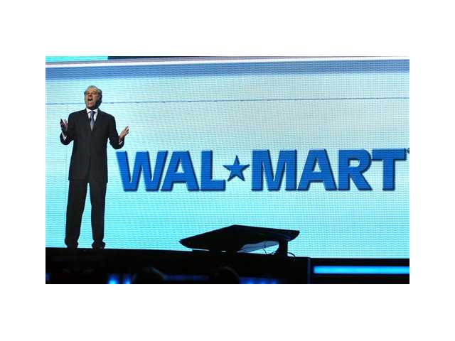 Eduardo Castro-Wright, then president and CEO of Wal-Mart Stores Inc., United States' division, speaks during the annual Wal-Mart shareholder's meeting in Fayetteville, Ark. Allegations that top executives at Wal-Mart Stores Inc.'s Mexican subsidiary bribed officials in that country could have huge implications for the world's biggest retailer.