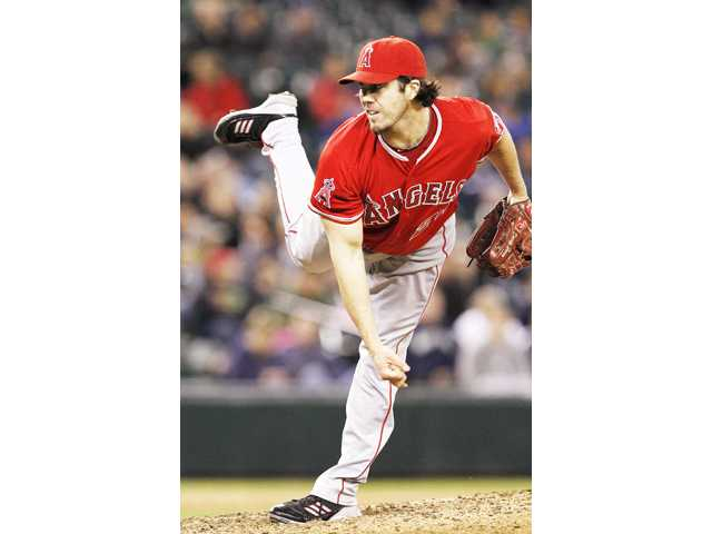 Los Angeles Angels starting pitcher Dan Haren follows through on a pitch against the Seattle Mariners in the eighth inning on Thursday in Seattle.