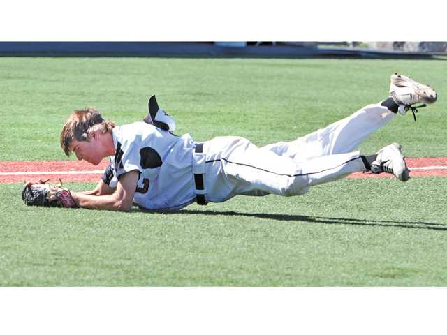 Santa Clarita Christian School Jake Kaiserski (55) tags out Dunn High's Ryan Layton on Friday at Reese Field.