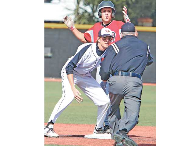 Santa Clarita Christian School shortstop Davis Muxlow, left, looks on as the umpire calls out Dunn High's Dominick Lawrence at second base on Friday at Reese Field.