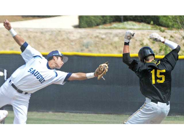 Saugus first baseman Austin Rodriguez reaches out to make the tag on Newbury Park's Matt Haskins during Friday's game at Saugus High School.