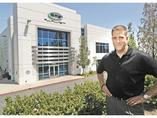 Mike Klepfer, executive vice president of operations, stands in front of AMS Fulfillment.