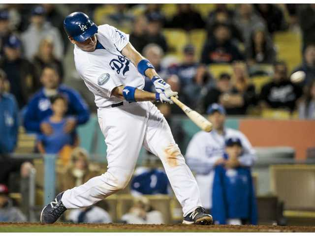 Los Angeles Dodgers catcher A.J. Ellis hits a walk-off home run during the bottom of the ninth inning against the Houston Astros on Saturday in Los Angeles.