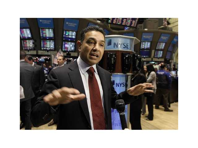 Sanjay Jha, Chairman and CEO of Motorola Mobility, is interviewed on the floor of the New York Stock Exchange after his company's stock began trading. Jha is one of the top 10 highest paid CEOs at publicly held companies in America last year.