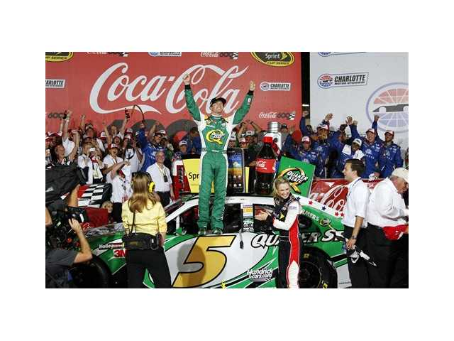 Kasey Kahne celebrates in victory lane after winning the NASCAR Coca-Cola 600 Sprint Cup Series auto race in Concord, N.C., Sunday