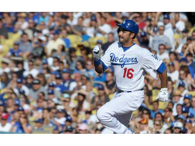 Dodgers outfielder Andre Ethier speeds toward second base after hitting an RBI double in the first inning against the Brewers on Monday at Dodger Stadium in Los Angeles.
