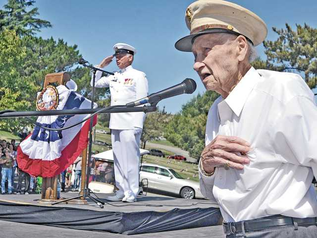 WWII veteran and U.S. Marine Corps pilot Tom Johnson, right, leads the Pledge of Allegiance as Duane Harte in  his U.S. Navy uniform salutes during the 2012 Memorial Day Tribute held at Eternal Valley Memorial Park and Mortuary in Newhall on Monday.