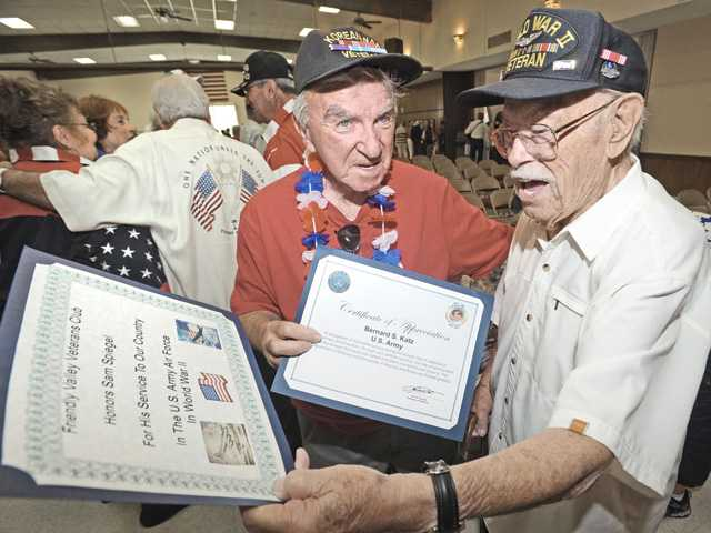 Korean War veteran Bernie Katz, left, chats with World War II veteran Sam Spiegel where they both received recognition for their military service at a Memorial Day ceremony held at Friendly Valley Auditorium on Monday.