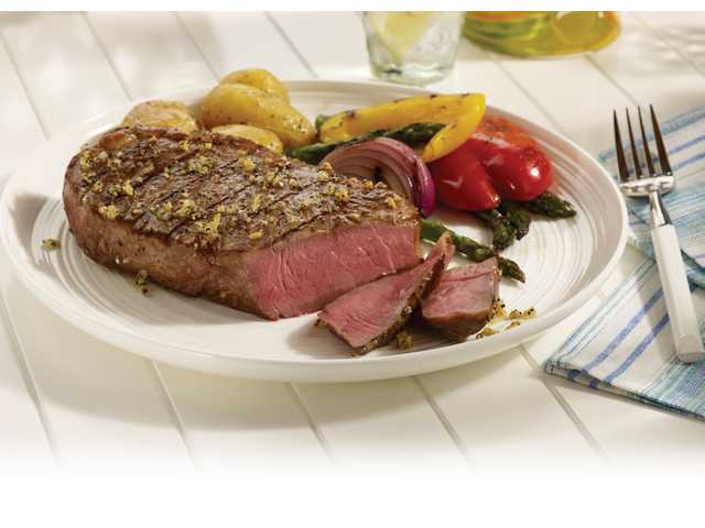 Peppercorn crusted strip steaks