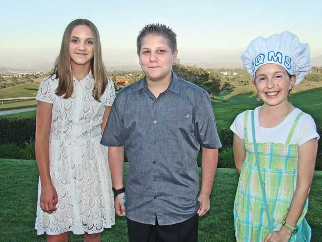 Left to right, young bakers, Claire Stevens, Brandon Gelfand and Jessy Serrano, entered the Sweet Charity Cake Auction and Competition.
