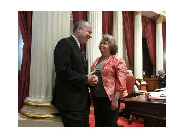 State Senate President Pro Tem Darrell Steinberg, D-Sacramento, smiles as he talks with Sen. Elaine Alquist, D-Santa Clara, after his school testing bill was approved by the Senate in Sacramento,
