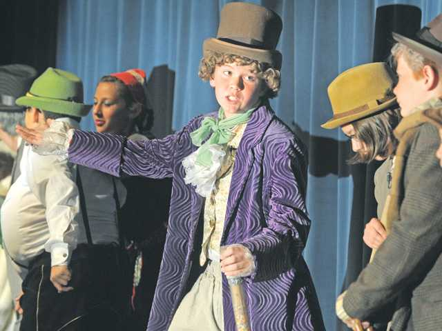 "Ethan Ross as Willy Wonka, center,  sings ""Pure Imagination"" as he prepares to take the group into the chocolate factory, during a dress rehearsal performance of ""Willy Wonka Jr."", which was presented by the Rosedell Drama Club at Rosedell Elementary School."