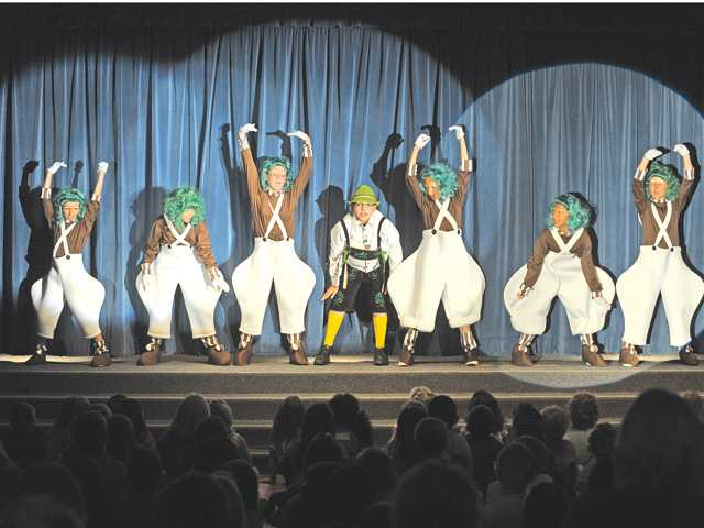 Oompa-Loompas dance during a dress-rehearsal performance of Willy Wonka Jr. presented by the Rosedell drama club at Rosedell Elementary School in Saugus on Wednesday.