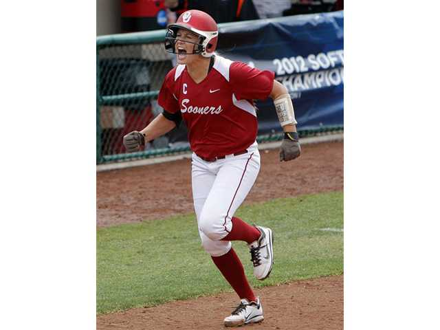 Oklahoma's Jessica Shults celebrates a grand slam against Oregon State during an NCAA college softball regional game, Sunday, May 20, 2012, in Norman, Okla.