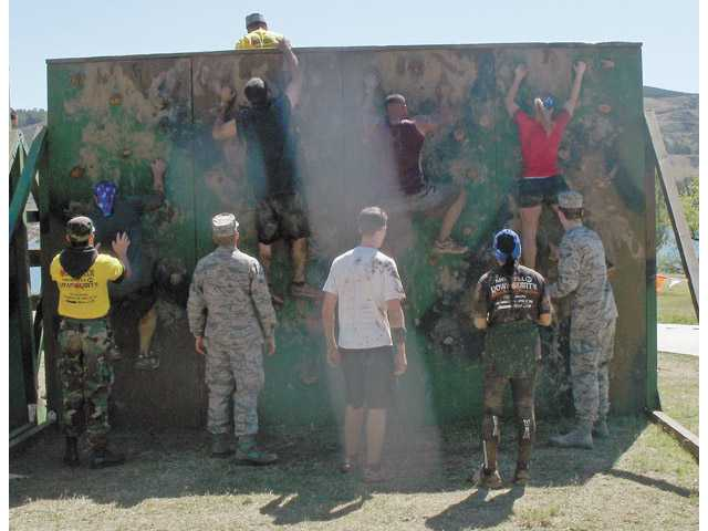 Participants climb a vertical wall during the most recent Merrell Down & Dirty Mud & Obstacle Series held at Castaic Lake in April.
