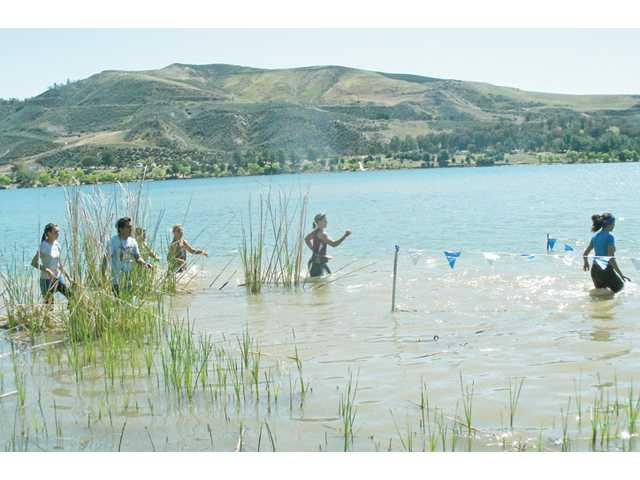 Participants run through waist-high water during the most recent Merrell Down & Dirty Mud & Obstacle Series held at Castaic Lake in April.