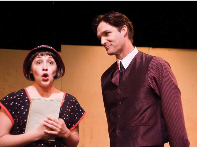 "Millie, played by Justine Celeste Meza, and Trevor, played by Kelly Roberts, share a moment in ""Thoroughly Modern Millie."""