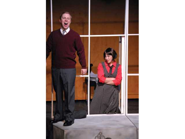 Millie and Jimmy, played by Tom Lund, at a window ledge.