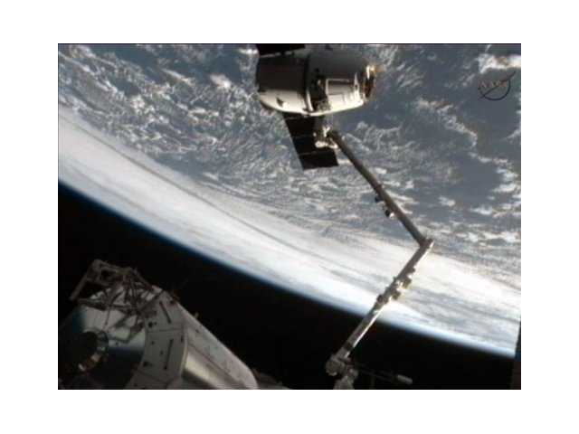 This framegrab image from NASA-TV shows the SpaceX Dragon capsule just after the capsule is released from the Canadarm2 Thursday morning.