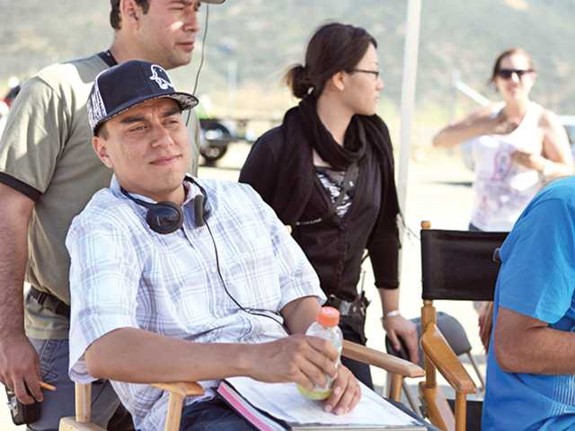 Director Nick Parada watches a rehearsal for a scene at the track shot at Pala Raceway in Pala. The film has been a journey years in the making for Parada and friends.