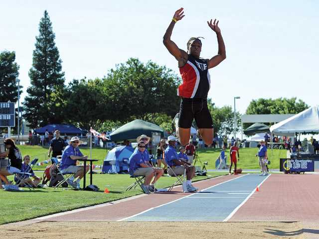 Hart senior Tim White competes in the triple jump finals during Saturday's CIF State Track and Field Championships on Saturday at Buchanan High School in Clovis.