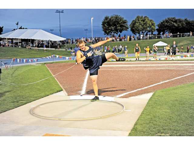 West Ranch's Nick Bultman throws the shot put on Saturday. He finished eighth in state.