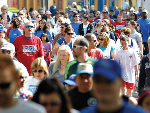Participants walk through the course at the Arthritis Walk at Magic Mountain on Sunday.