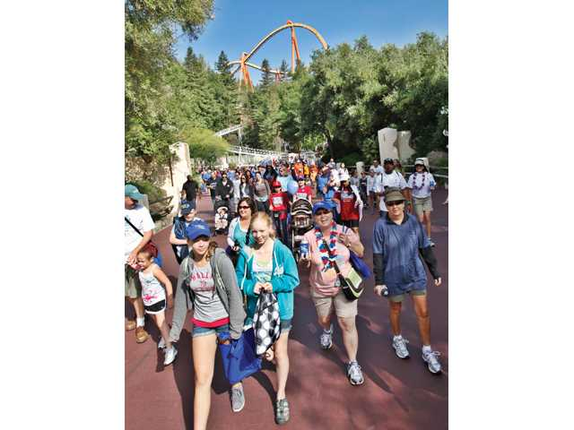 Participants take part in the Arthritis Walk at Magic Mountain on Sunday.