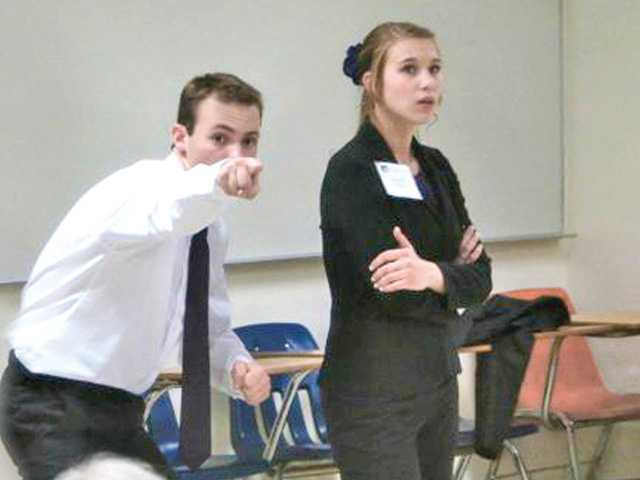 Local kids Zack Seals and Hannah Ruzicka perform their duo interpretation during a recent speech tournament at Concordia University in Irvine.