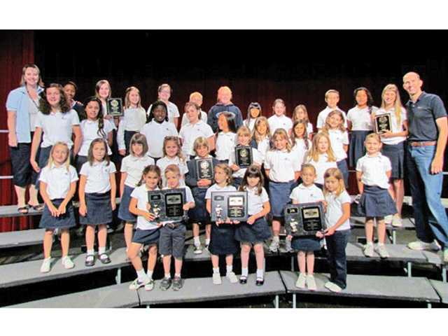 Trinity Classical Academy students show off their wins at the Forum Music Festival.
