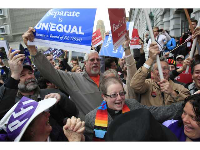 Supporters of gay marriage react outside the James R. Browning United States Courthouse after a federal appeals court declared California's ban on same-sex marriage unconstitutional in San Francisco.