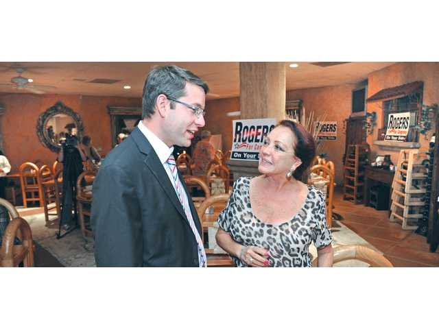 Candidate Dr. Lee Rogers, left, chats with local business owner Nancy Cueva at El Trocadero Restaurant in Newhall.