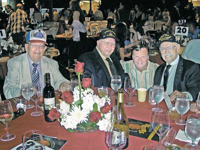 "Left to right, World War II veterans Lee Bell, Ed Reiff and Sam Spiegel, with Santa Clarita City Councilman Bob Kellar, second from right, were honored at the 41st annual Benefit Auction for the Boys & Girls Club of Santa Clarita Valley. The event celebrated the theme ""Heroes Among Us"" and was held June 2 in empty commercial space in Valencia."
