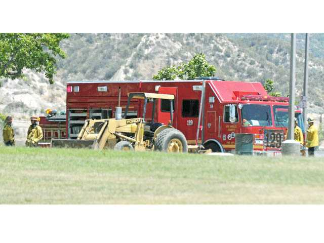A Los Angeles County Fire Department Hazardous Material Squad is seen staged at Canyon Country Park on Wednesday. A suspicious balloon drew the attention of authorities.