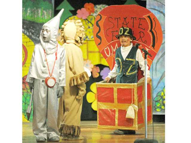Tinman Noah Garcia, Lion Joshua Talamantes and Wizard of Oz Evan Lavo in a scene from the play.