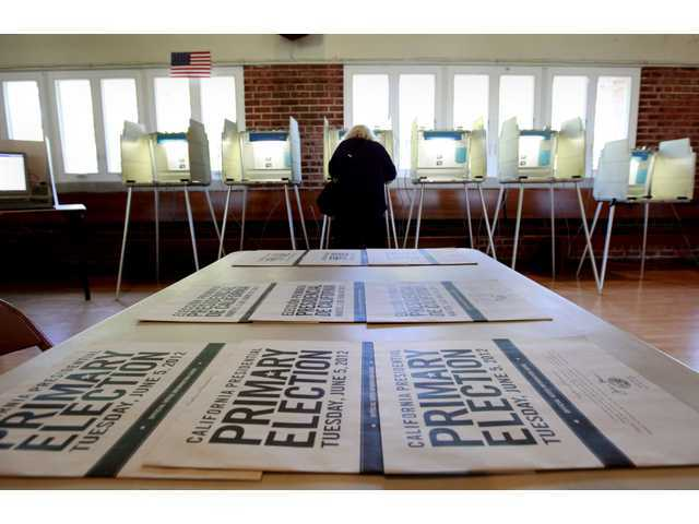 A voter marks her ballot while voting in the California primary in Sacramento on Tuesday.