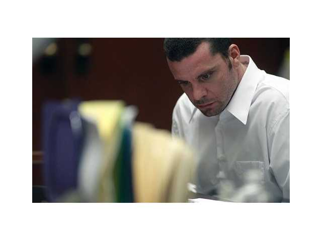 Defendant Marvin Norwood looks down as Corey Maciel, a friend of victim Bryan Stowe, testifies during a preliminary hearing Wednesday in Los Angeles Superior Court. Norwood is one of two suspected of beating San Francisco Giants fan Bryan Stow i
