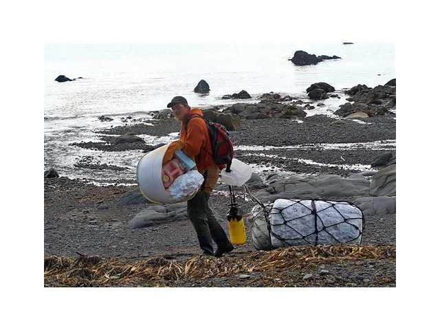 Patrick Chandler removes tsunami debris on Montague Island near Seward, Alaska. More than a year after a tsunami devastated Japan, killing thousands of people and washing millions of tons of debris into the Pacific Ocean, neither the U.S. government nor some West Coast states have a clear plan for how to clean up the rubble.